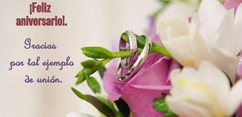 Felicitaciones de aniversario en imagen de anillos.